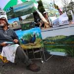 hombre vendiendo pinturas