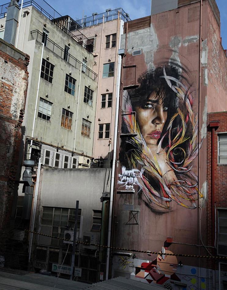 mural en edificio por Adnate y Shida 1