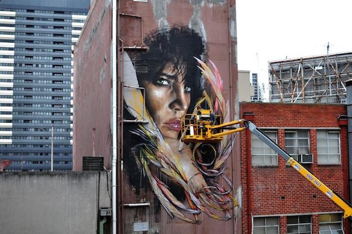 mural en edificio por Adnate y Shida 2