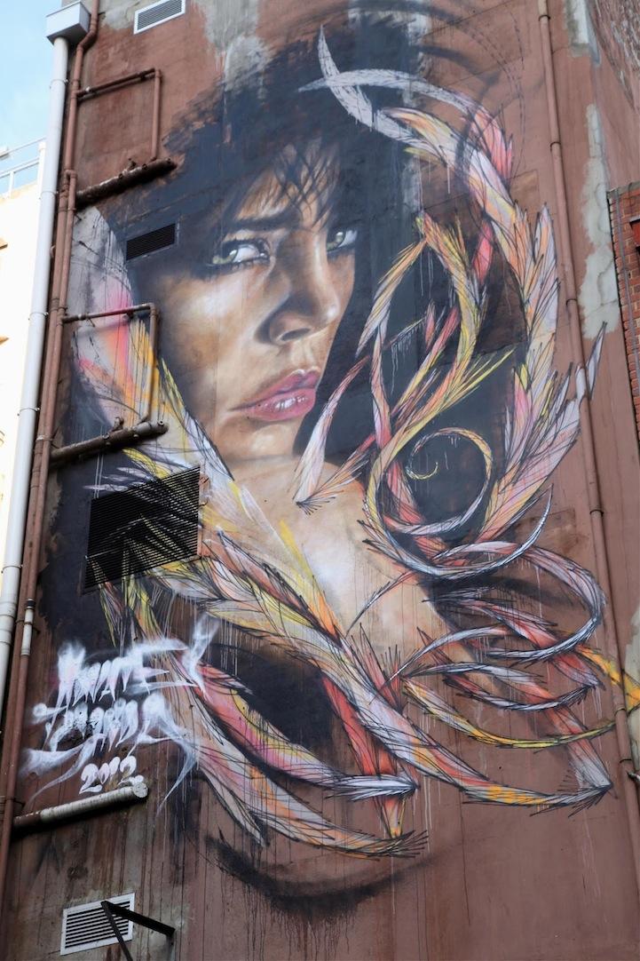 mural en edificio por Adnate y Shida 4