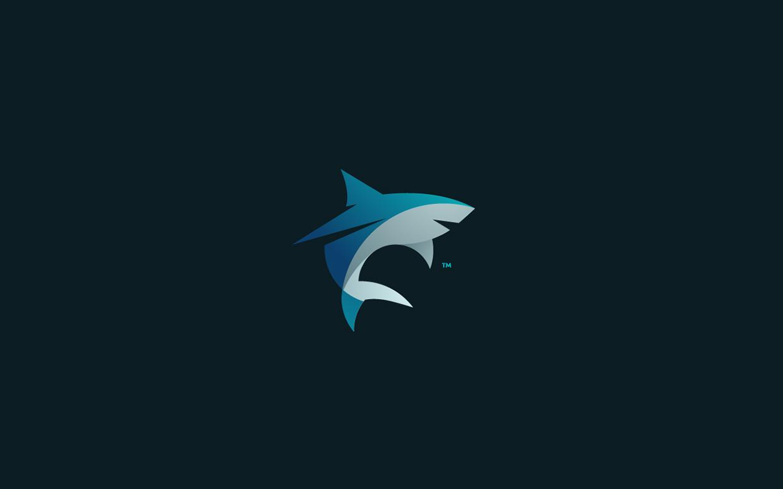 logos minimalistas animales tiburon